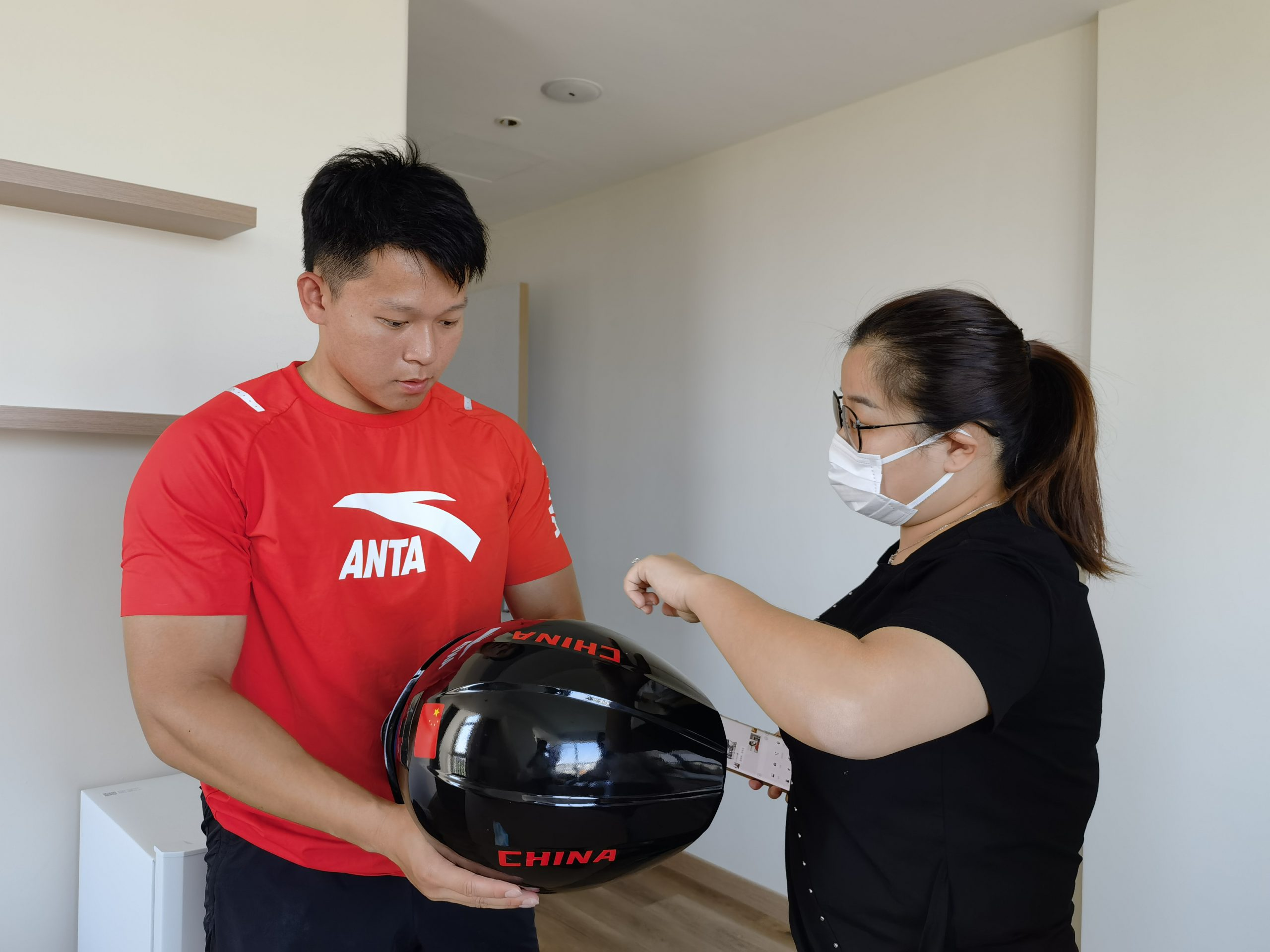 Interacting with athletes using head protective gear
